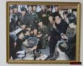 Kim Il-sung entouré par des soldats